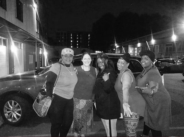 Image of Autumn Louise with four women after a self-care event all smiling and gesturing in excitement.